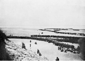 British troops queuing to be taken off the beach